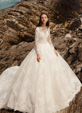 Eden – Long sleeve lace gown with a structural fabric and long train